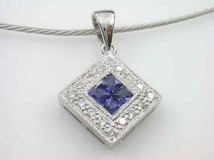 Ladies 18ct Sapphire and Diamond Pendant.