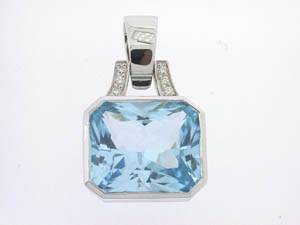 Ladies 9ct White Gold Blue Topaz and Diamond Set Enhancer.