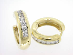 Ladies 18ct Yellow Gold Channel Set Diamond Huggies.