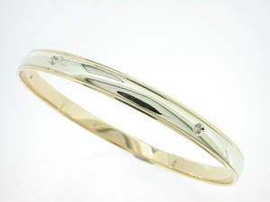 Ladies 9ct Yellow and White Gold Diamond Set Bangle.