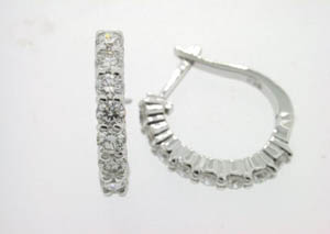 Ladies 18ct White Gold Diamonds Claw Set Huggies.