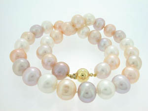 Ladies Freshwater Pearl Strand. Pink and Apricot Shades 12-13mm