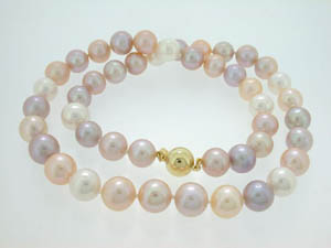 Ladies Freshwater Pearl Strand. Pink and Purple Shades 10-11mm R