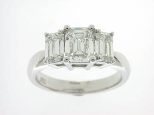 Ladies 18ct White Gold 3 Stone Emerald Cut Diamond Ring.